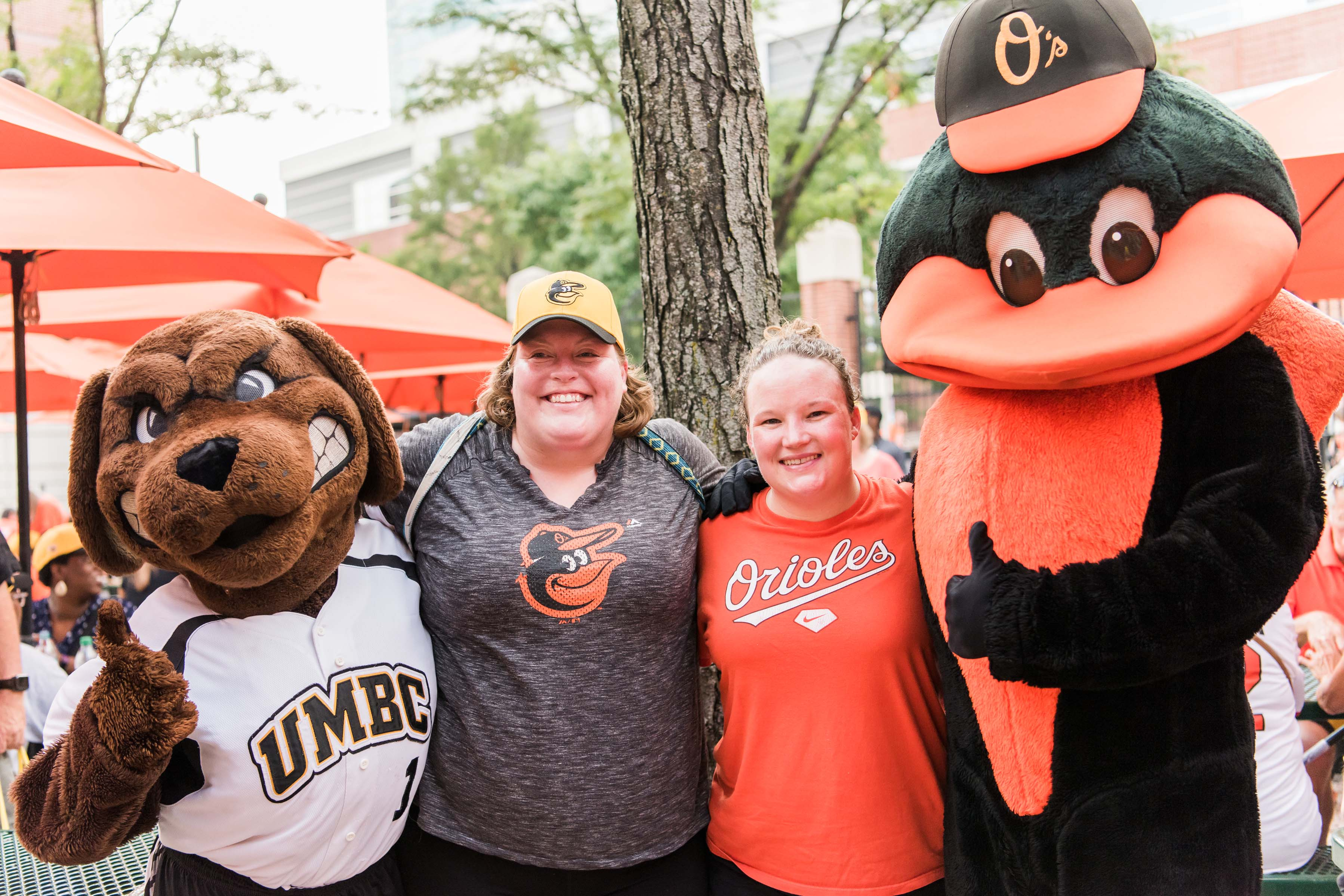 Orioles and UMBC mascot posing with fans
