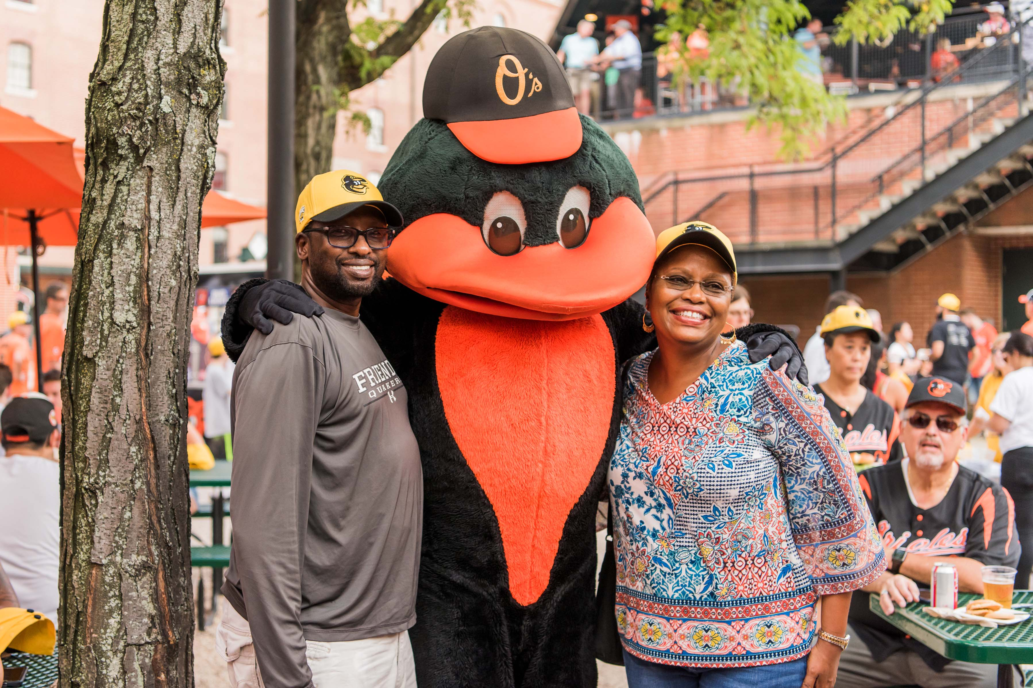 Orioles mascot poses with fans