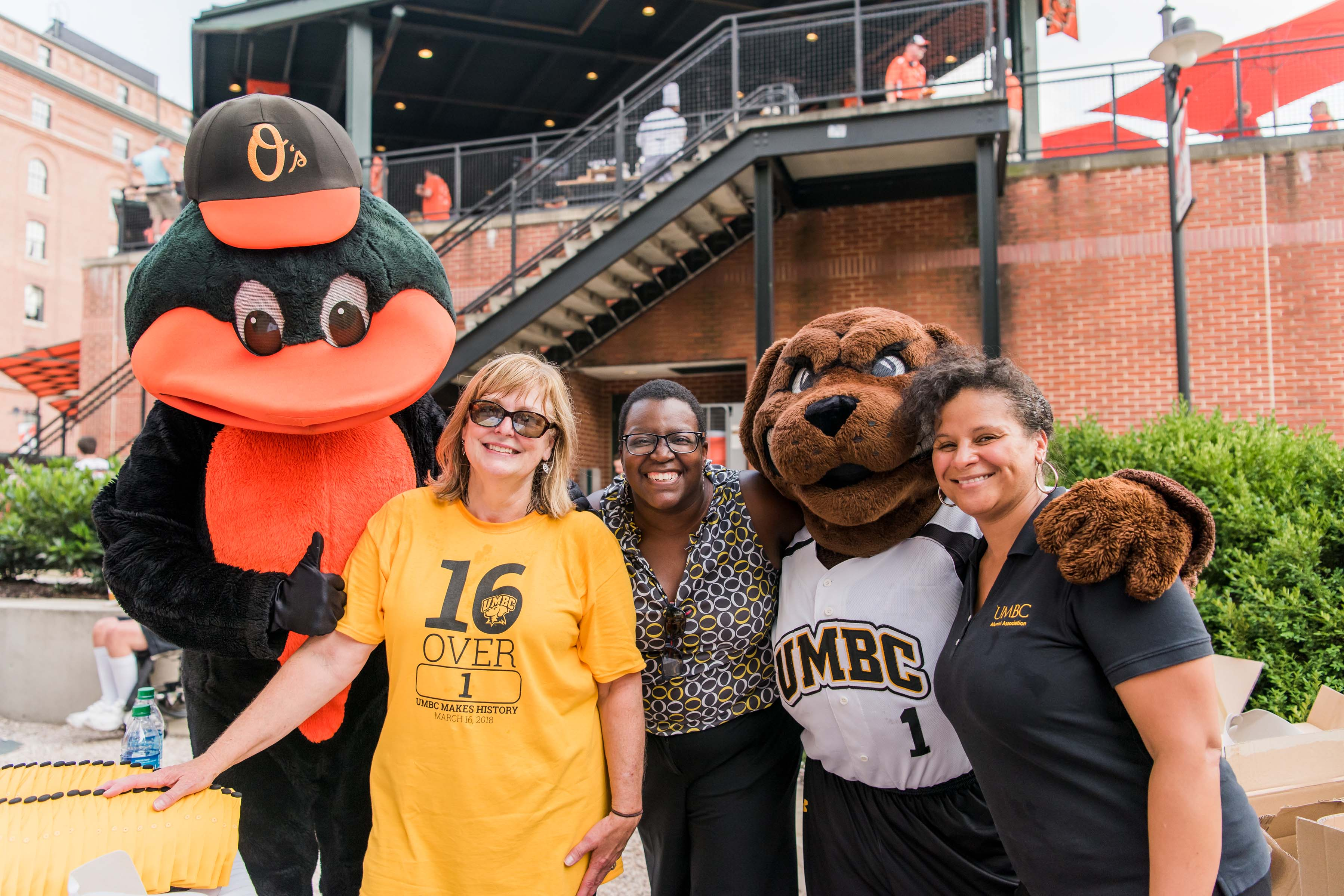 Orioles and UMBC Mascot pose with fans