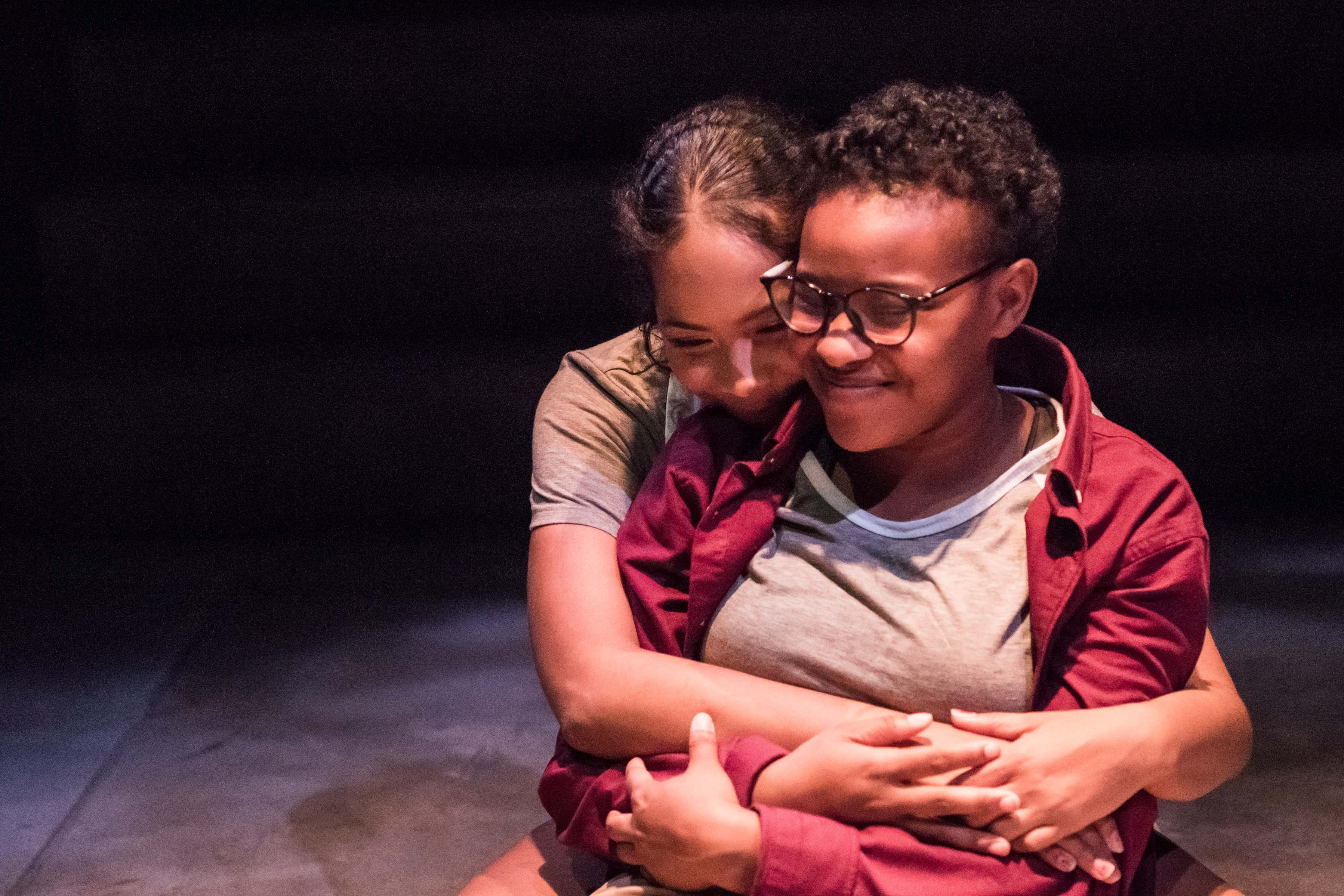 Two girls hugging at rehearsal for she like girls play