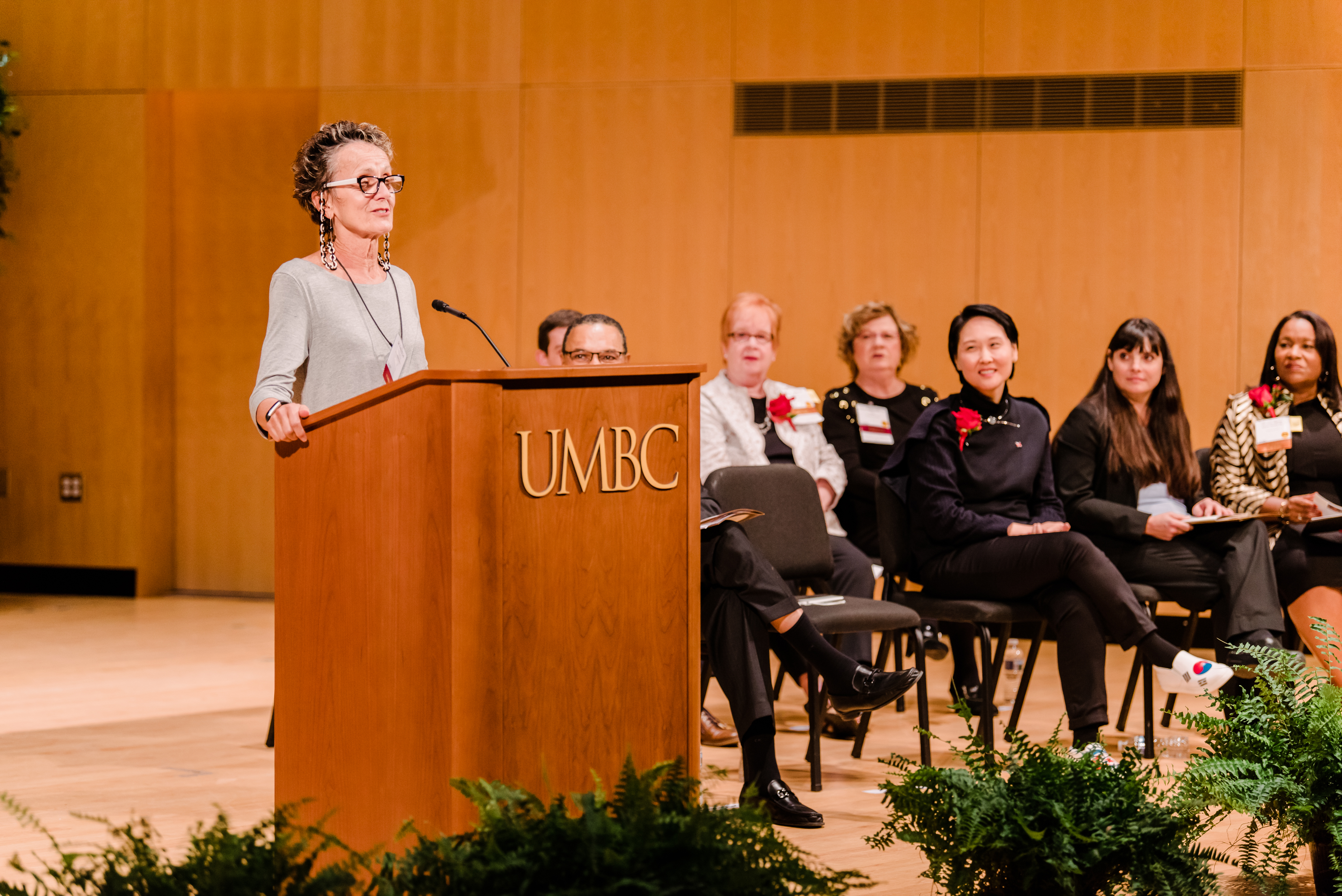Woman gives speech for alumni awards