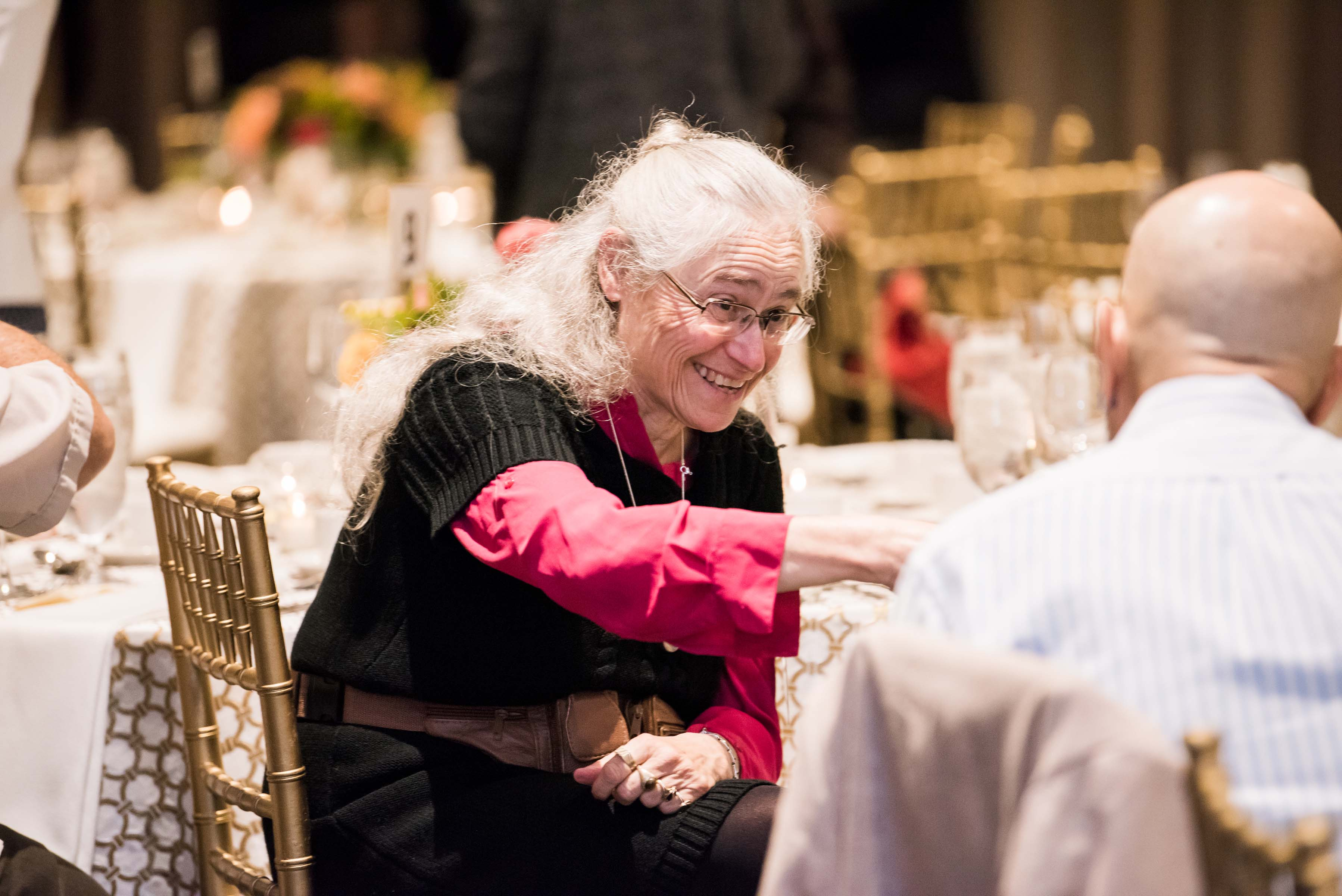 Miriam Kelly laughs at table