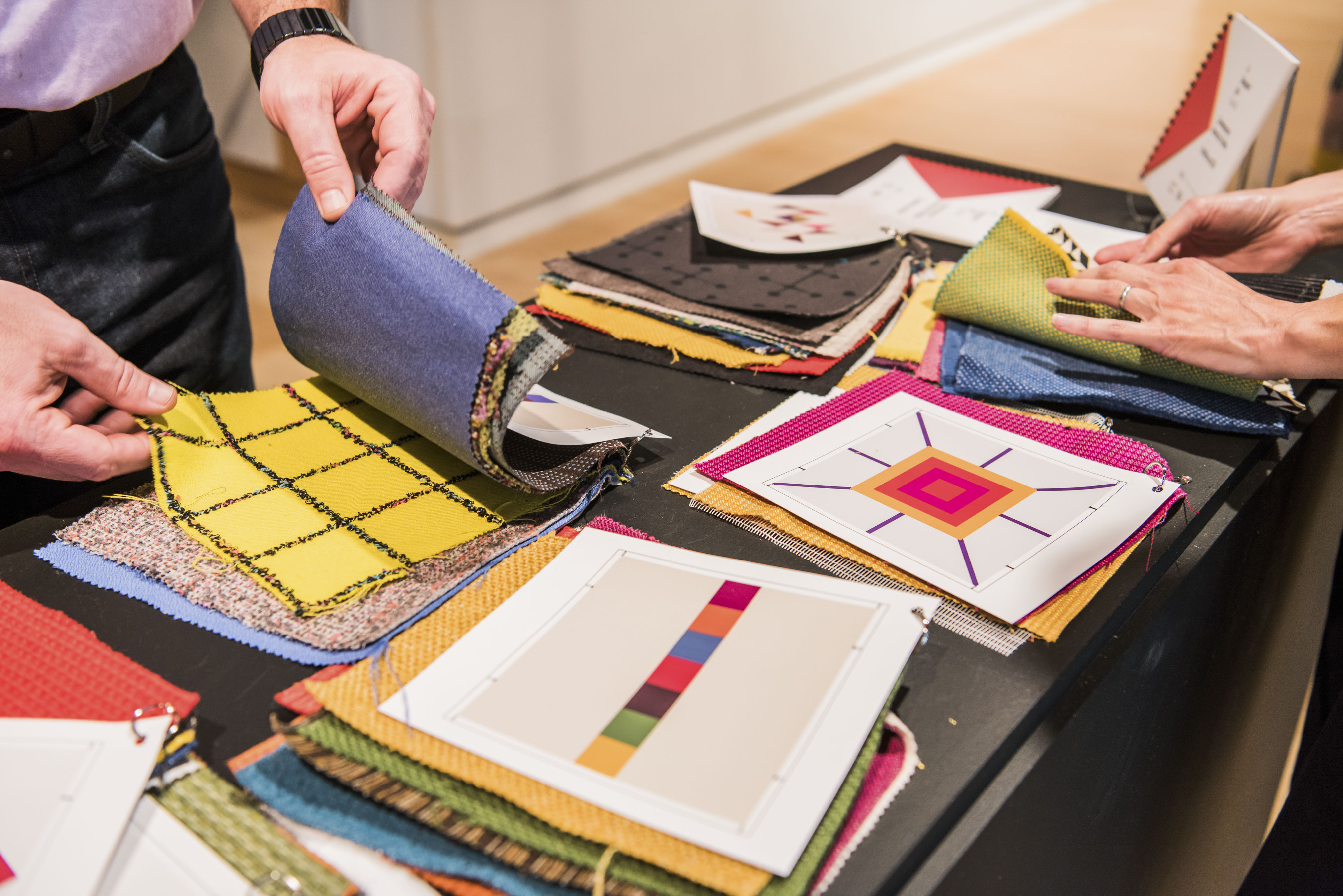 People flip through fabrics