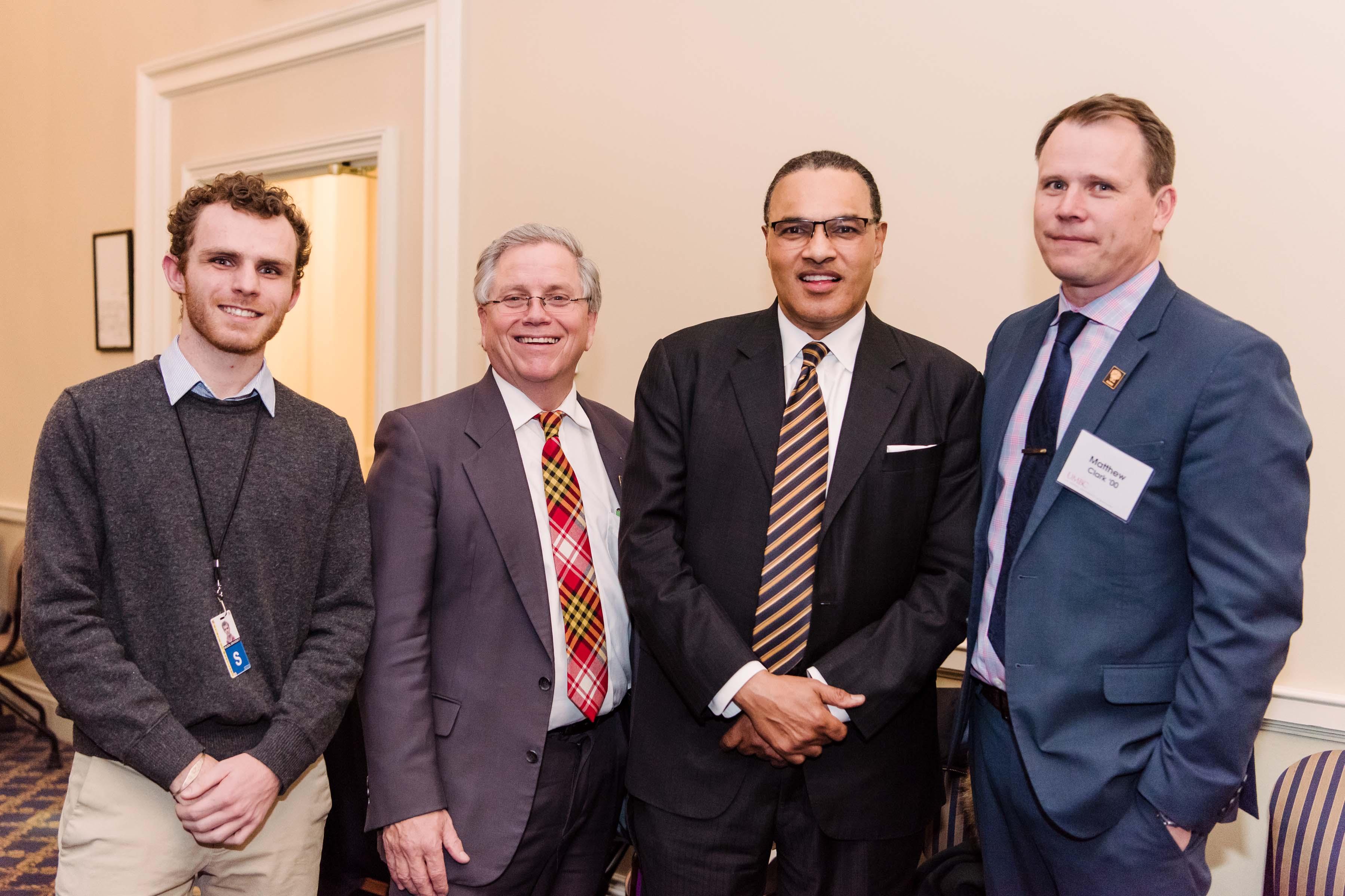 Hrabowski poses with three others at Annapolis alumni reception