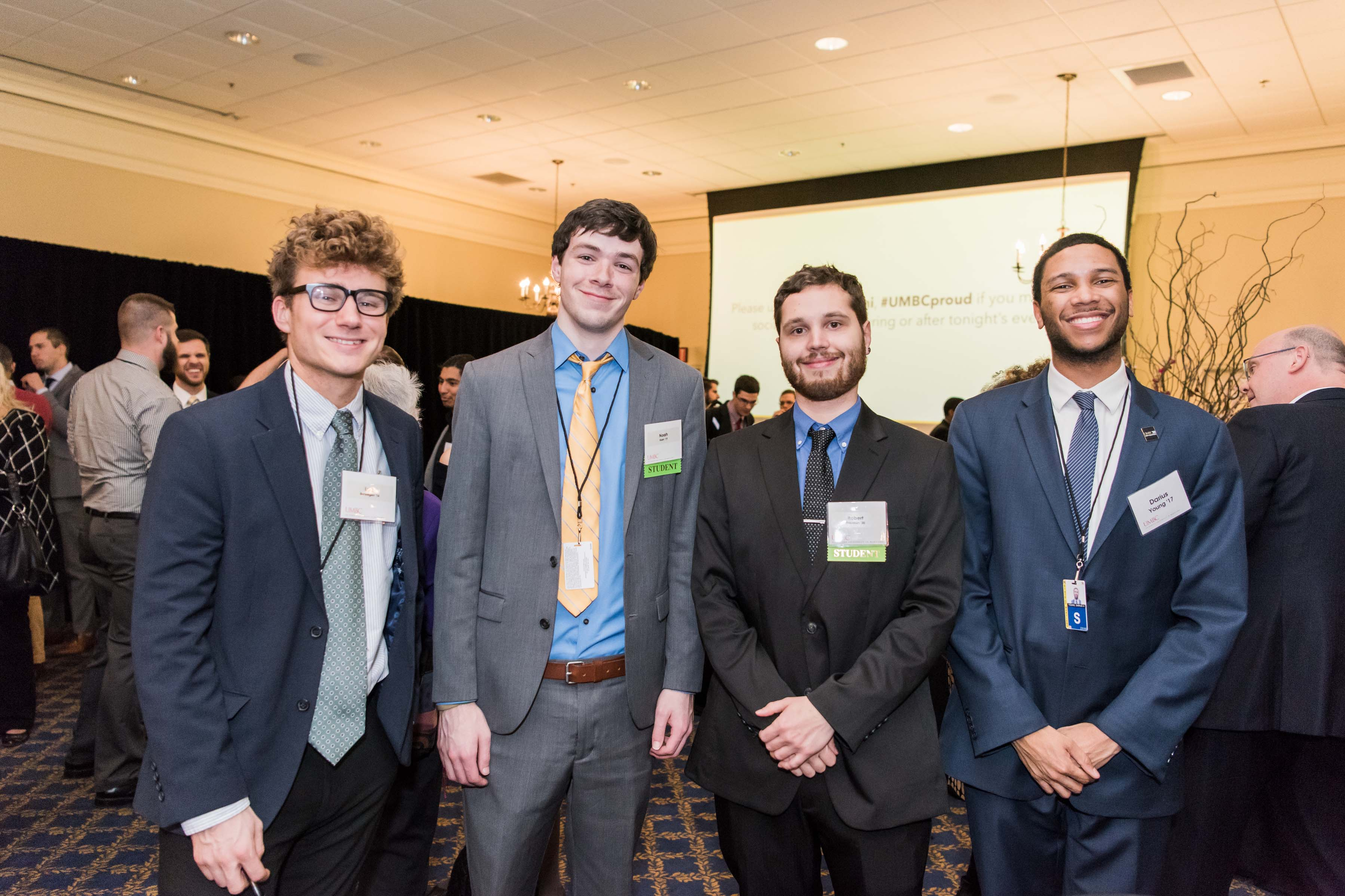 Four men stand side by side at Annapolis Alumni Reception
