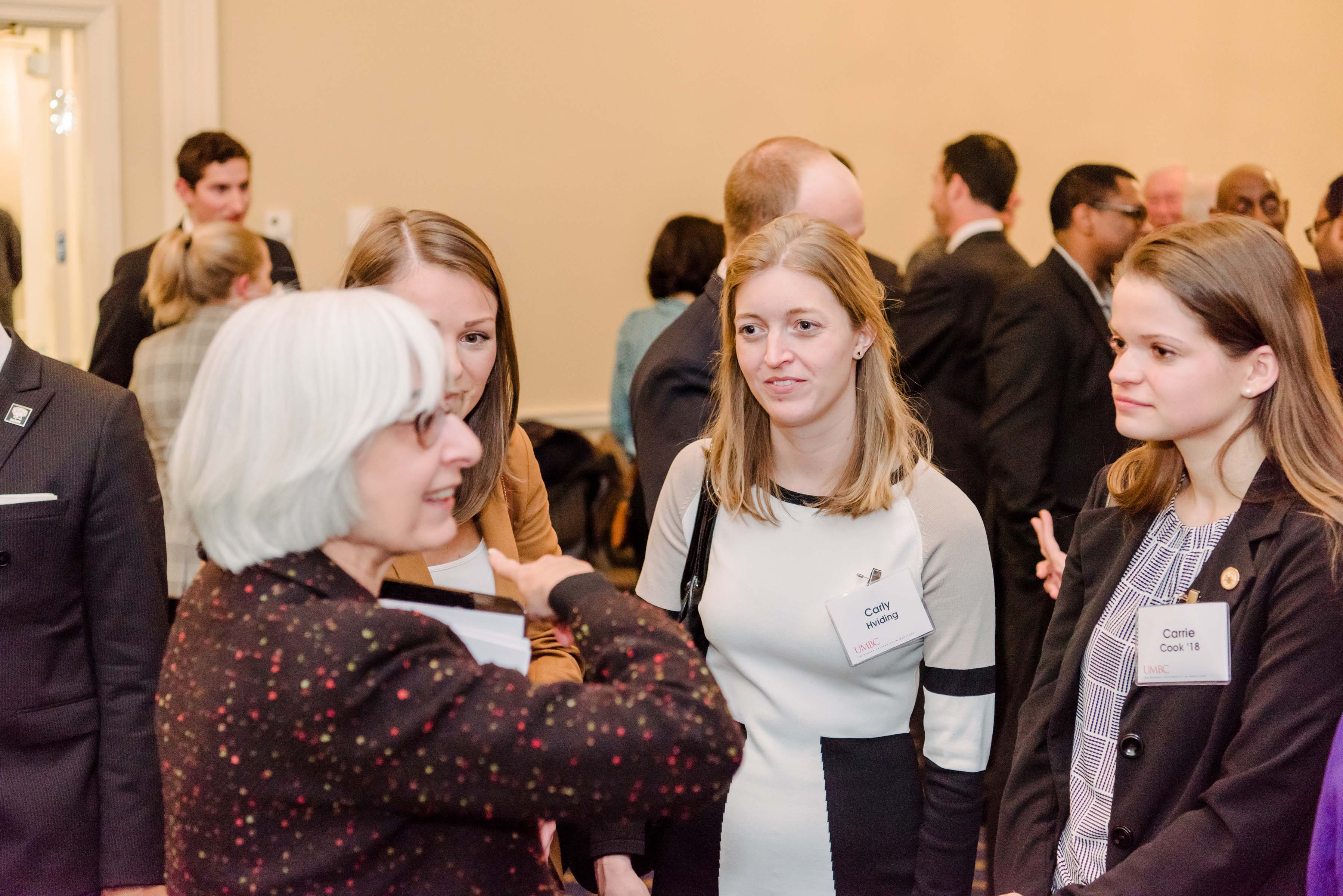 Group of women talk at Annapolis alumni reception