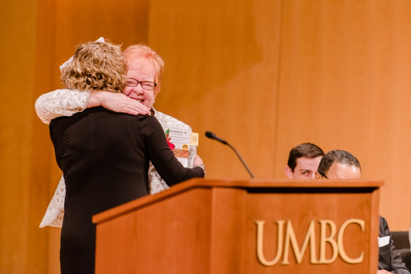 Dietrich hugs Donna Banks Hekler '70, at the 2018 Alumni Awards ceremony.
