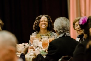 Women smiling around table at scholarship luncheon
