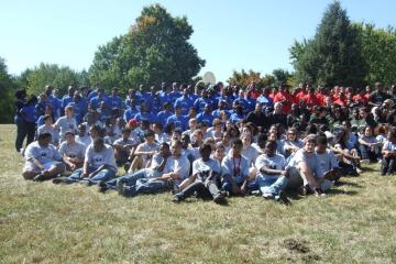 Large group of people with different colored meyerhoff shirts on