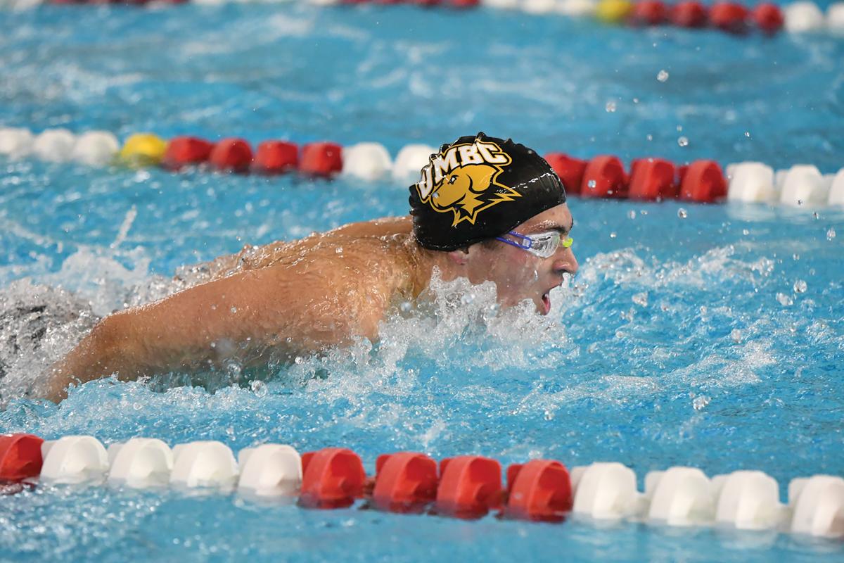 Swimmer performs butterfly stroke