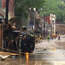 EHS workers respond to the scene in Ellicott City. Permission from Baltimore Sun Media. All rights reserved.