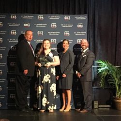 Women is presented with Young Entrepreneur of the Year award