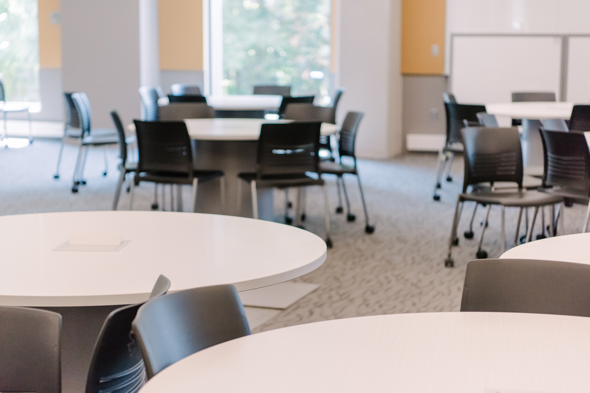 chairs circling tables in ILSB