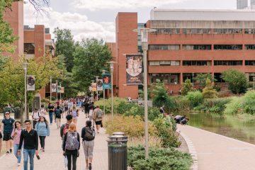 Students walk down academic row