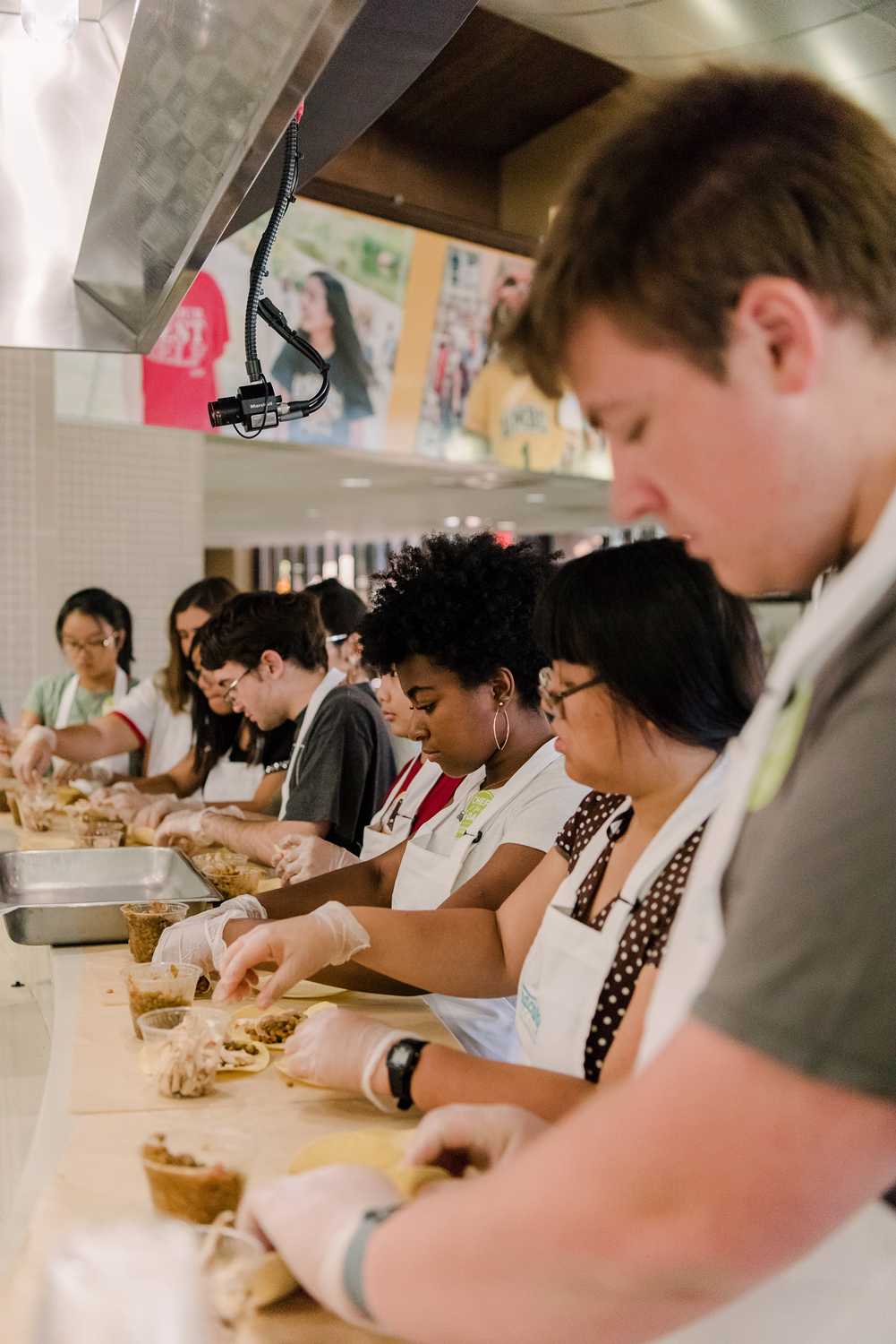 students in aprons in cooking line