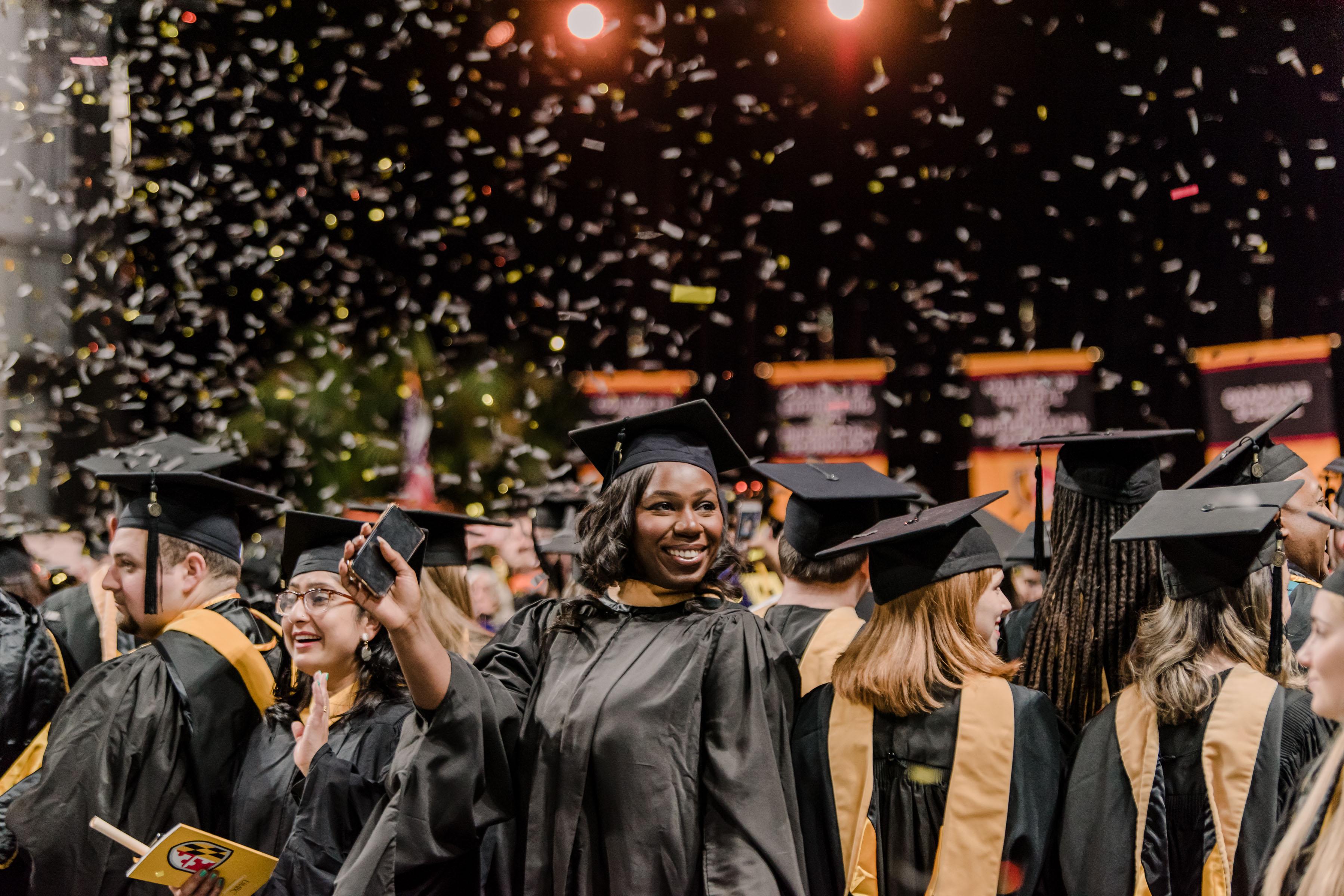 graduates smiling in confetti