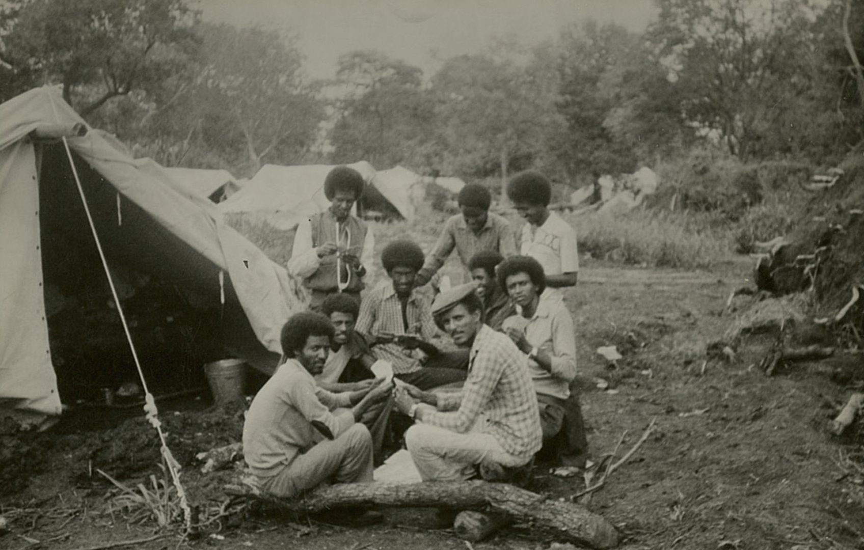 Black and white photo of black people camping