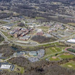 2019 aerial photo of UMBC's campus, featuring the new Event Center