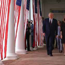 President Trump walks with Amy Coney Barrett