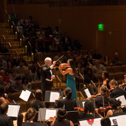 orchestra performing before audience