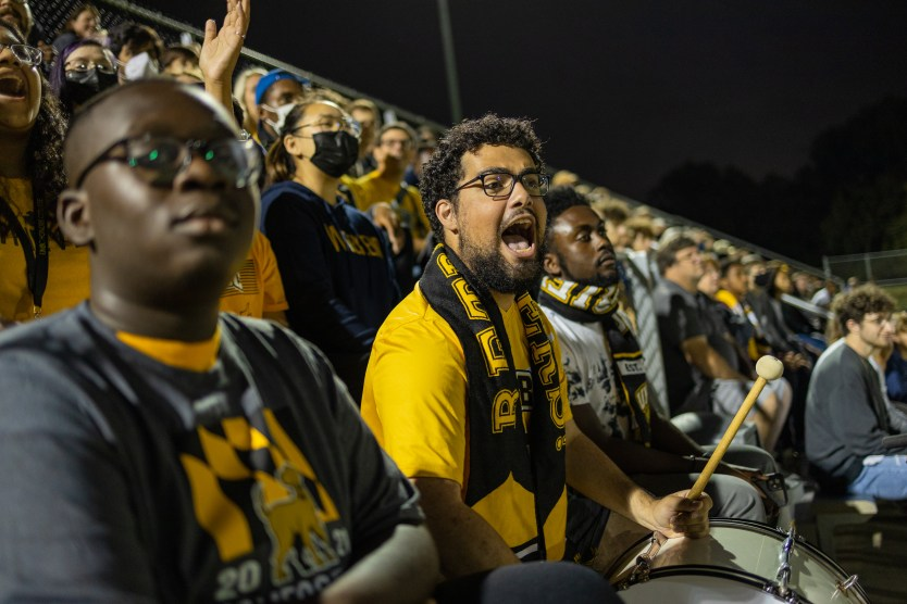 Fans giving it their all at a October soccer game.