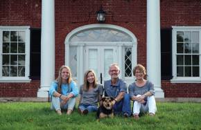 The Paino family at home with Oscar: from left, Chloe, Sophia, Troy, and Kelly.