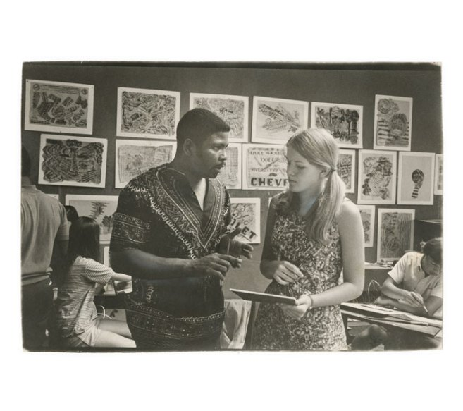 By the time artist and teacher Johnny Johnson joined the faculty at Mary Washington, he had established himself as a community leader who guided area young people through the emotionally fraught 1960s. Here he chats with a Mary Washington student in 1968.