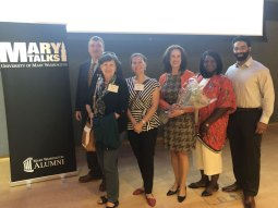 Professor of Political Science Elizabeth Freund Larus (holding bouquet) is pictured at the year's first Mary Talk. With her (from left) are Thomas Larus, Maria Riegger, Erica McBride, Shirley Martey Hargis '16, and Jacob Hargis '14.