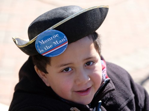 Ramsey Belyamani, age 6, and his parents enjoyed the pageantry of the tribute to James Monroe's presidential inauguration. (Photo by Norm Shafer)
