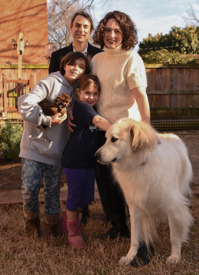 Heather and Andrew Crislip met at Mary Washington the first week of their freshman year, 1991. They live in Richmond with daughter Grace, pictured holding backyard chicken Barley, daughter Renna, and their dog, Zeus. (Photo by Clement Britt)