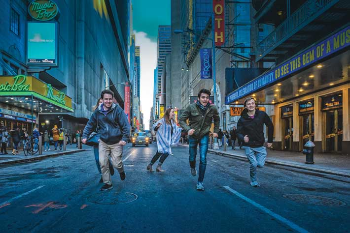 Theatre students went to New York City over spring break to interview pros in the business and see as many shows as possible. Shown here on Broadway are, from left, Jacob Savage '18, Olivia Whicheloe '19, Abe Shaikh '19, and Neal Gallini-Burdick '19. Lauren Frautschi '18 is behind at left. Photo by Clinton Brandhagen.