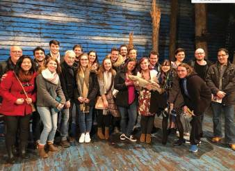 UMW theatre students shadowed Arturo Porazzi, stage manager of Come From Away at the Schoenfeld Theatre, before seeing the show. Afterward, they had a Q&A with the cast, and Porazzi gave them a tour. Pictured above, the class poses on the Schoenfeld stage with Porazzi, front row, third from left. The intensive New York research trip is one aspect of Ideas in Theatre, a class funded in part by a UMW research grant. Photo by Jon K. Reynolds '07.