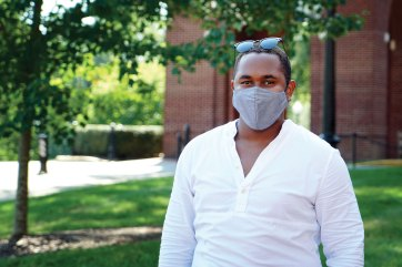 It became second nature for UMW students to grab a mask on the way out the door. 2020-21 Student Government Association president Kyree Ford sported the look shared by those taking in-person classes. [Maria Schultz, M.Ed. '11]