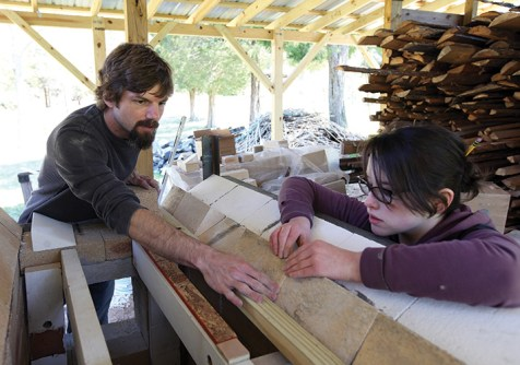 McMillan works with Katie Sleyman to build a wooden arch form.