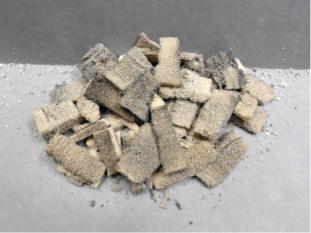 A pile of used chemical sponges and draft clean powder after cleaning the prints.