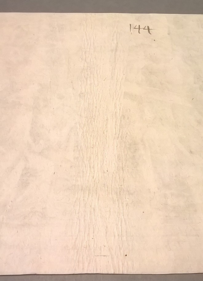 Fig. 4 - Indentations in the paper left by the rope it was dried on
