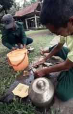 Washing the bonang, an instrument of gamelan ensemble. Magelang Regency, November 23, 2013.