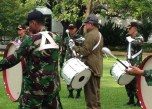 President Susilo Bambang Yudhoyono playing tenor drums with the Indonesian Military members.