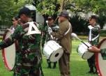 President Susilo Bambang Yudhoyono playing tenor drums with the Indonesian Military members.
