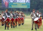 Mr SBY, right, playing tenor drums with the Canka Lokananta Pipes and Drums members.