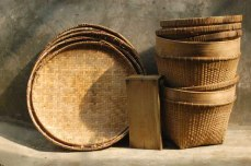 The tampah (bamboo round trays), the telenan or wood cutting board, and the tenggok, woven bamboo baskets.
