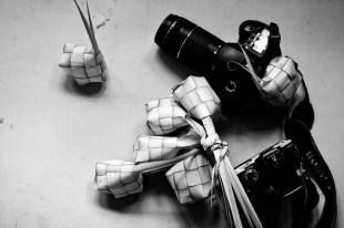 Woven palm leaves (ketupat pouch) and my cameras.