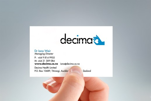 hand-held portrait of Decima Health business card, two colours, black and blue, two-sided card design, symbol and name on front, symbol and positioning statement illustration on back