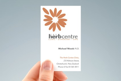 hand-held portrait of Herb Centre Clinic / Dispensary / Café business card, two-sided design, two colour, orange and grey, type and symbol logo, Healthcare, Brand and identity systems design, Illustration