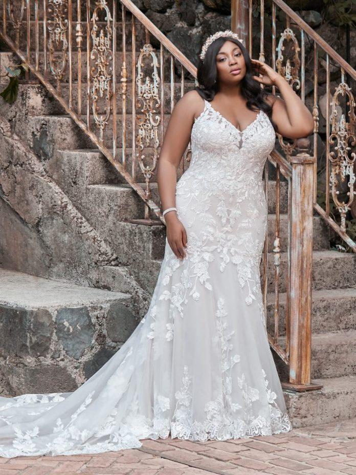 Curvy bride wears a large boho wedding dress named Giana Lynette by Maggie Sottero