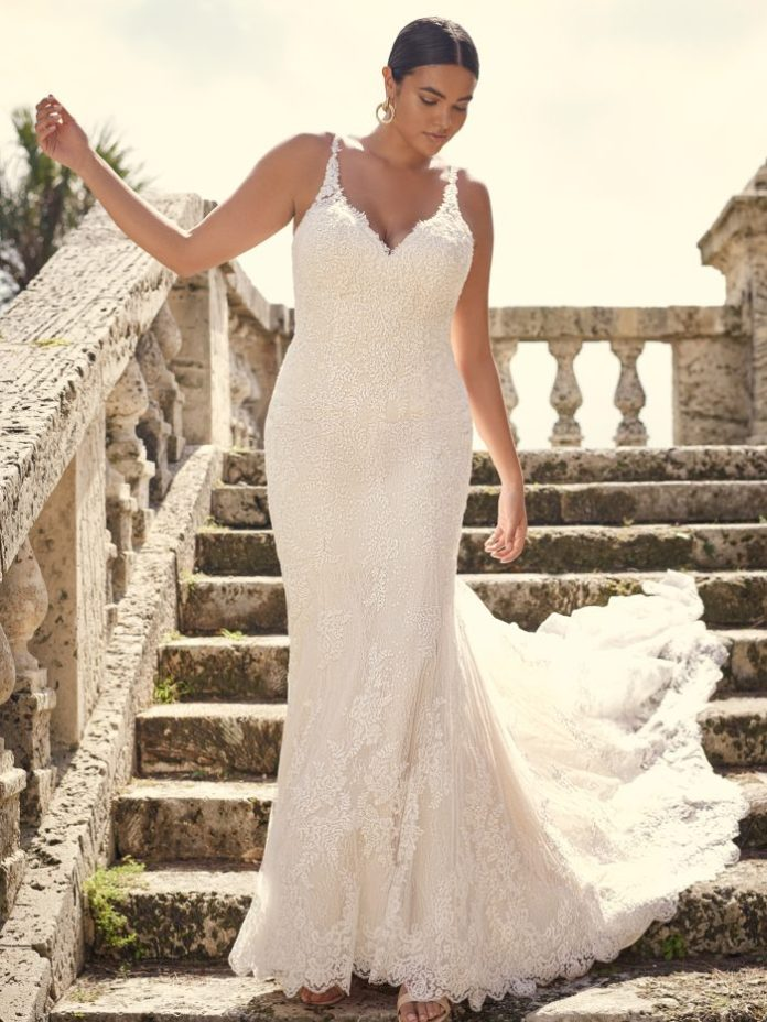 Bride with lace sheath Oversized wedding dress called Dublin Lynette by Sottero and Midgley