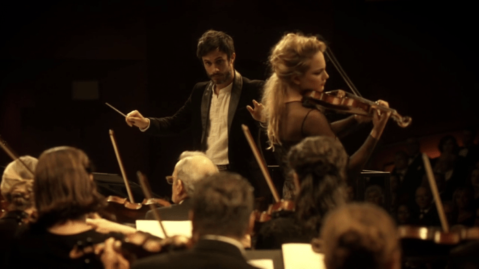 Rodrigo conducts the orchestra and Anna-Maria