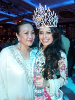 Maggie Loo with Aileen Gabriella Robinson, Miss Tourism International 2011 upon her crowning