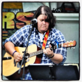 Rocking Pilot Mountain Mayfest in 2011. Back before my hair had class...