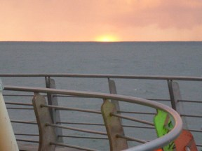 The sun sinks into the Pacific Ocean.